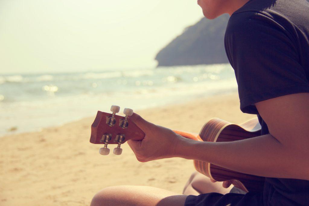 playing ukulele in hawaii